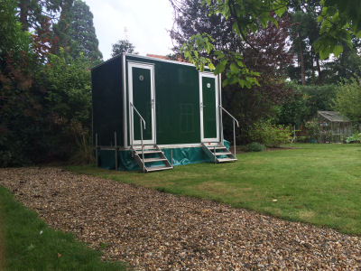 1+1 Luxury toilet hire units in a garden
