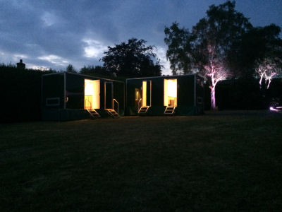 Multiple sweet pea luxury toilet units at night