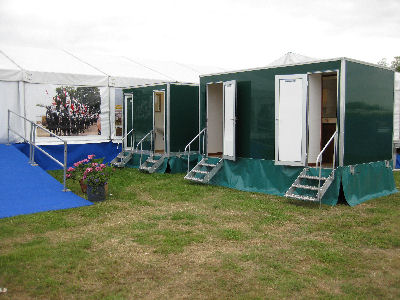 Multiple sweet pea luxury toilet units at a show