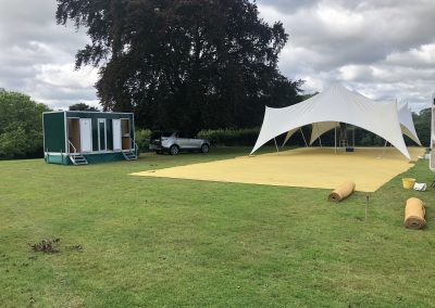 1+1 Luxury Toilet hire unit next to a capri marquee in Surrey